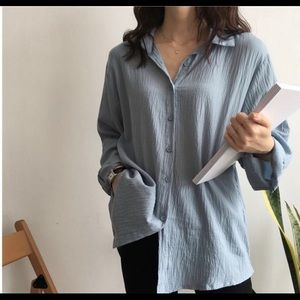 Blue crinkled long sleeve top